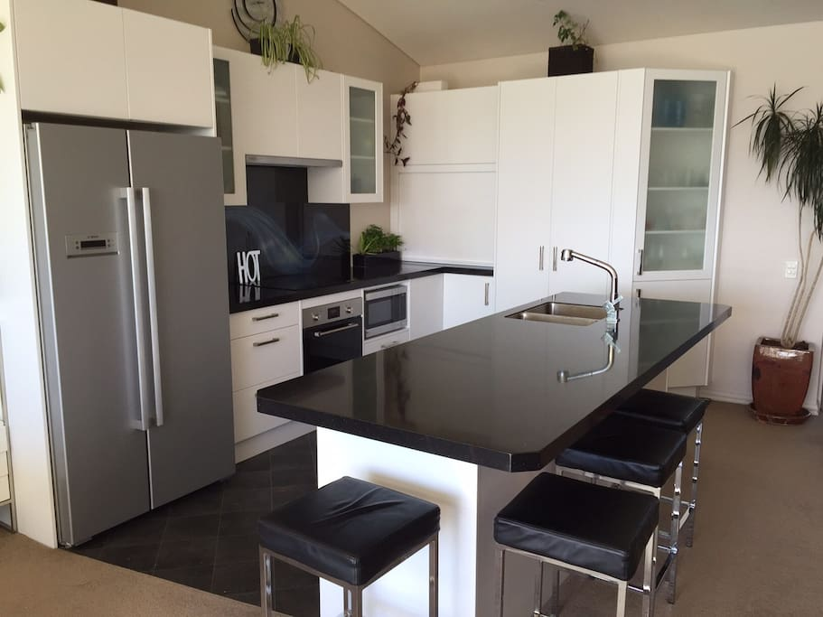 A large and spacious kitchen, great for sitting at and having a wine!