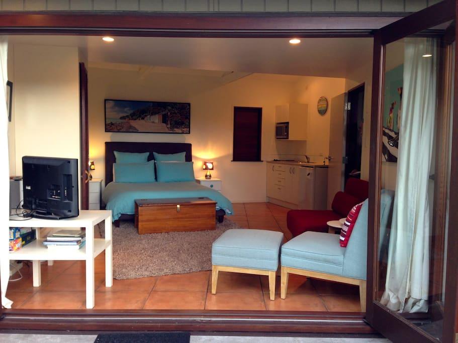 Bifold doors open studio to garden