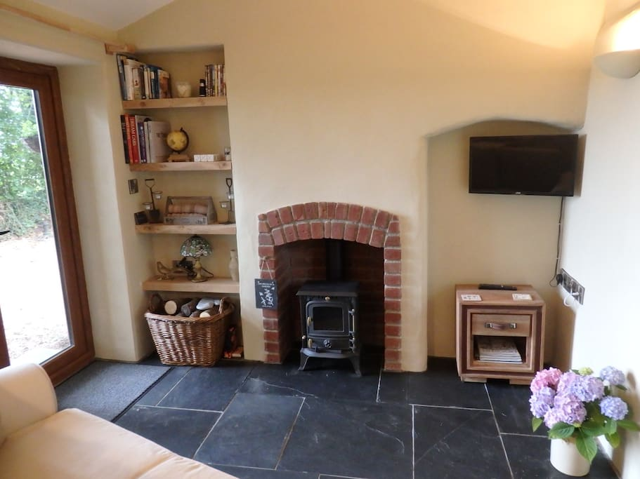 Living room with woodburner, sofabed, tv/dvd, wifi and  patio doors leading onto your private patio area with views over the surrounding countryside.