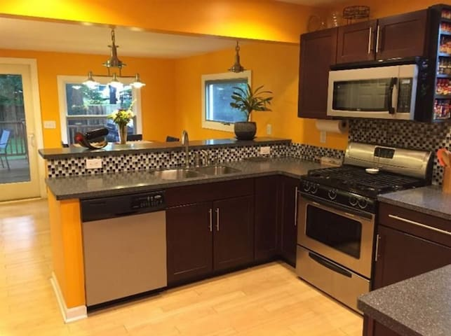 Kitchen with eat in dining room behind counter
