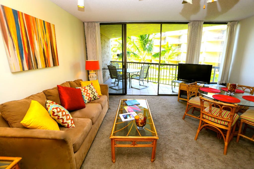 An inviting living and dining space with dining  on the lanai (balcony)