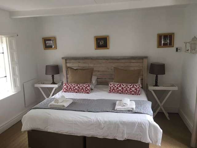 comfortable large bedroom with clean , fresh linen and can be presented as singles as well.