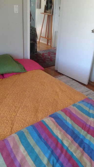 low bed; throw rugs