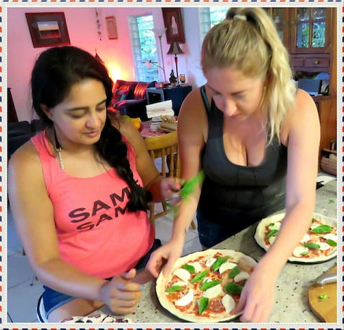 Two lovely guests preparing their own pizza.