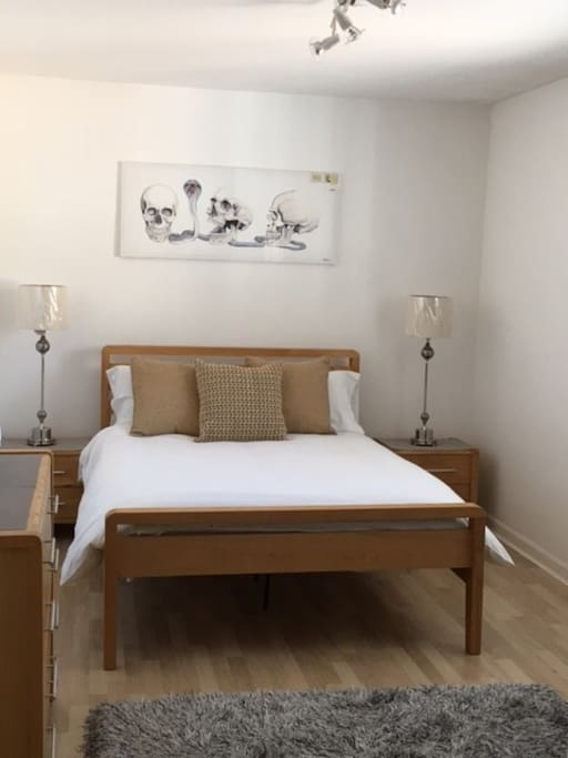 Spacious double bedroom with ample storage including fitted wardrobes.