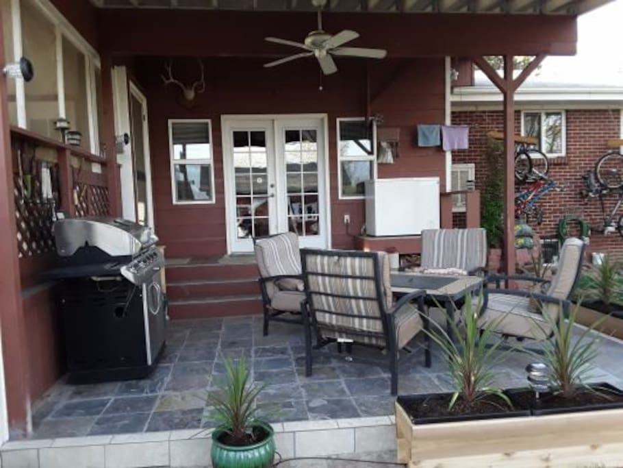 Back yard patio w/ bar-be-cue and fire pit.