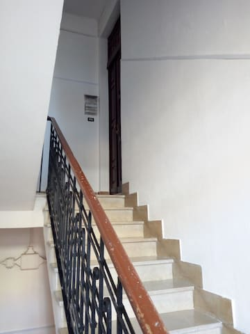 The Upstairs to the apartment at first floor