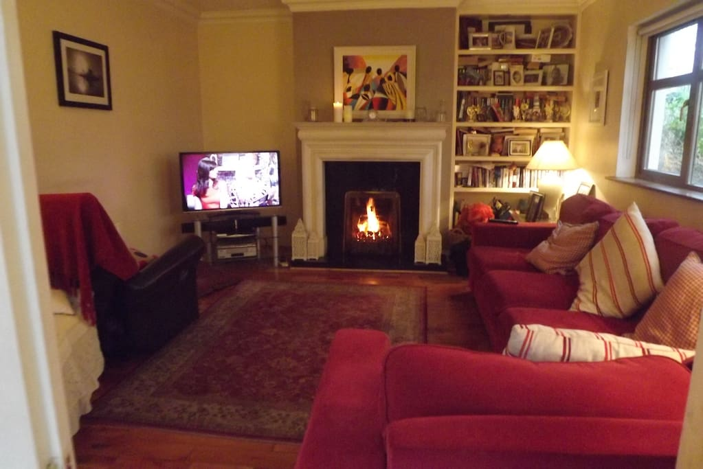 Sitting Room with TV and open fire off kitchen area