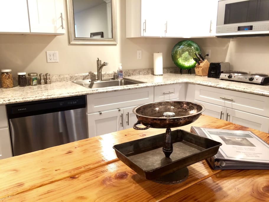 Brightly lit kitchen is located in the great room style layout.