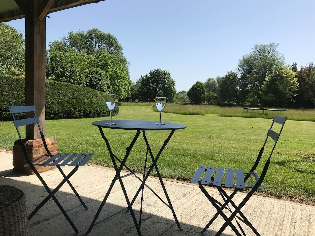 Secluded seating area overlooking private meadow. Perfect for those warm evening drinks
