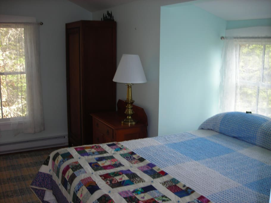 Second bedroom on the second floor with a queen size bed