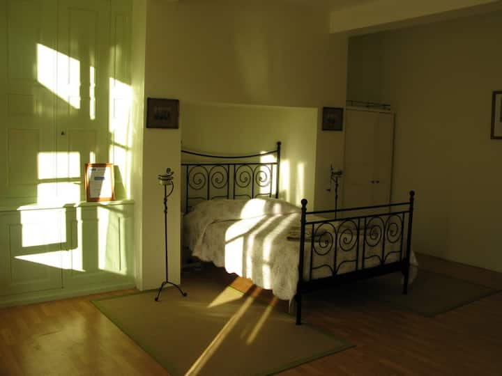 Spacious bedroom in a house from the 1830