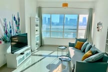 Bright, open living room, sofa is a new double sofa bed, large balcony with sea and city view. Blackout curtains in living room.