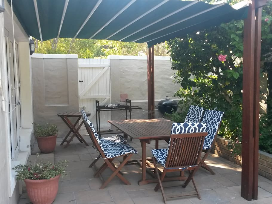 One of two patio's, this one has a roll out awning, the other is a covered pergola.
