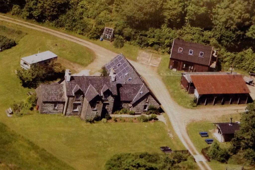 This is an aerial view of Seafield Farm.  Stable Cottage is one half of the wing attached to the right hand side of  the farmhouse.  The road is ours so there is no through traffic.  On the right hand side of the road you can see the barbecue hut, firewood barn and basketmaking workshop.