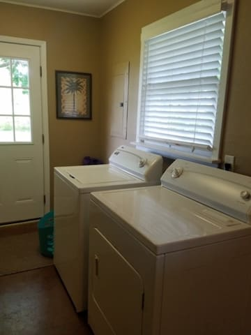 Landry room with full size washer and dryer