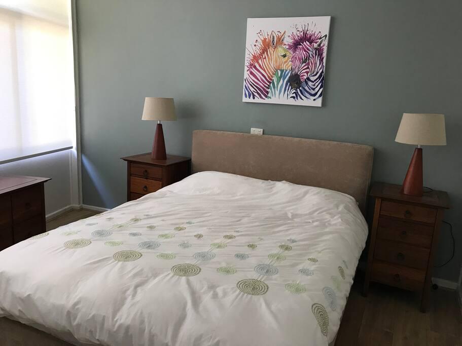 Queen size bed in separate bedroom