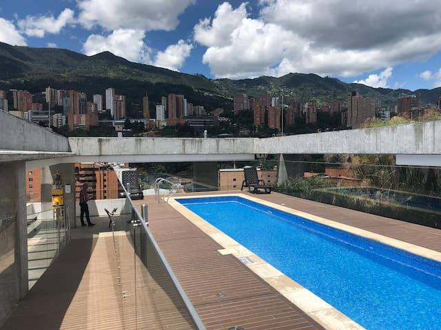 Rooftop deck with sauna, gym and pool with views in all directions.