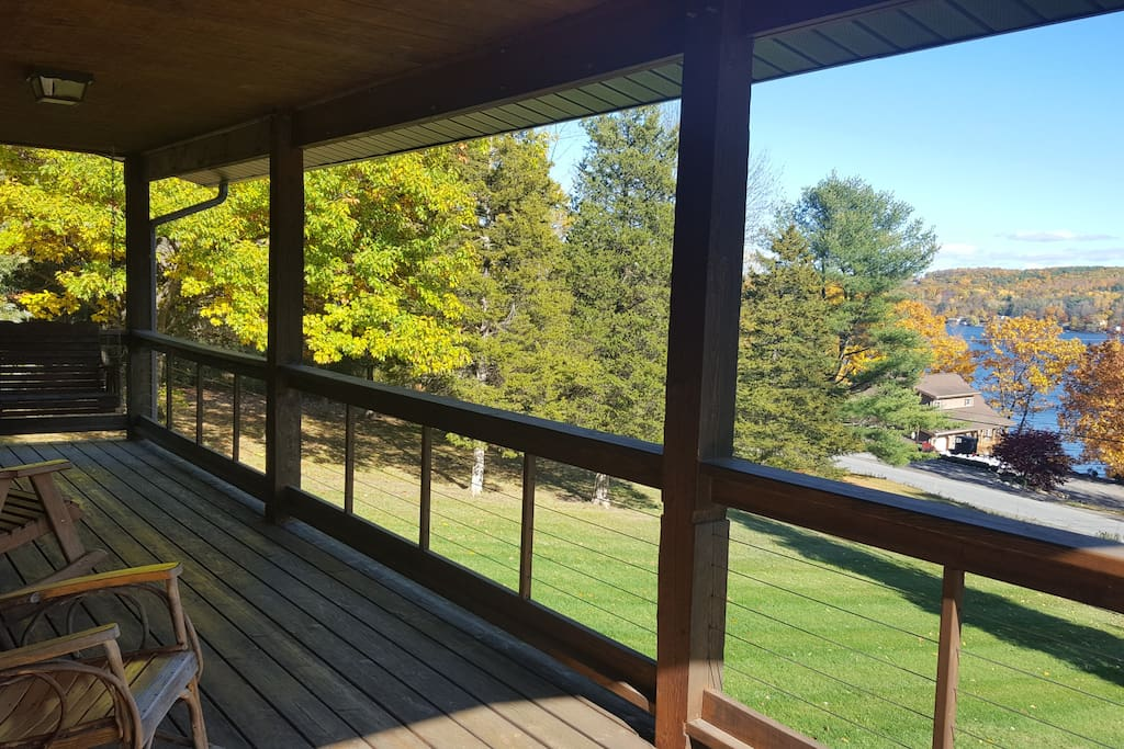 Large covered porch with lake view