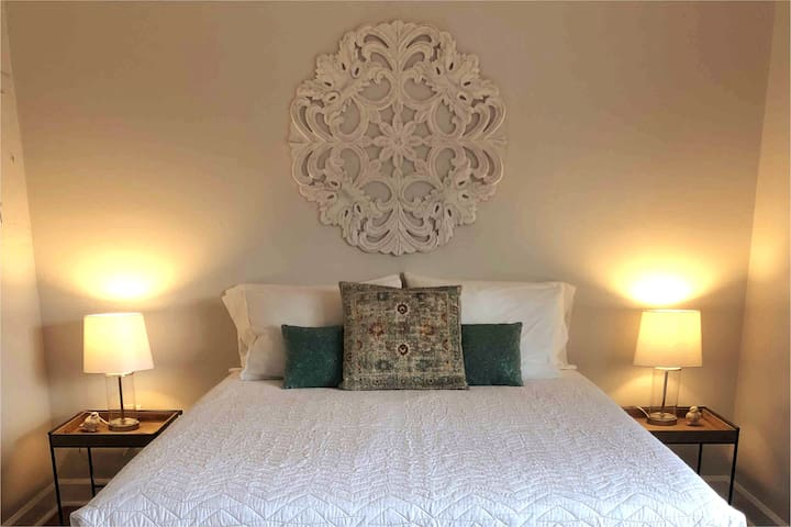 """The master bedroom is outfitted with a queen mattress, a gel-infused cover, microfiber sheets, and down + feather blend pillows. A recent guest called it """"the most comfortable bed I've encountered in an Airbnb!"""" :)"""