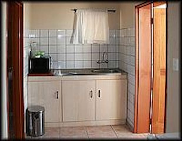 Small kitchen in single room