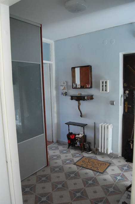 The room is in the hallway, next to the entrance door, so has privacy.