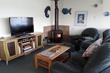 Cosy living area with the fire going 24/7 during winter.