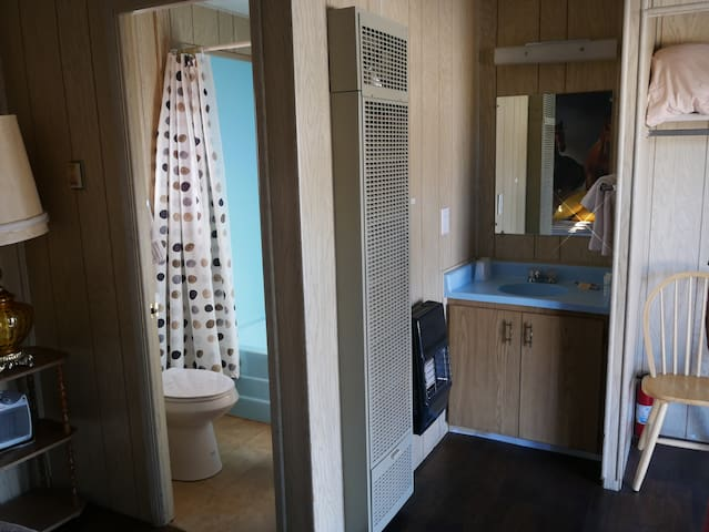 Bathroom area, vanity and sink and closet space.