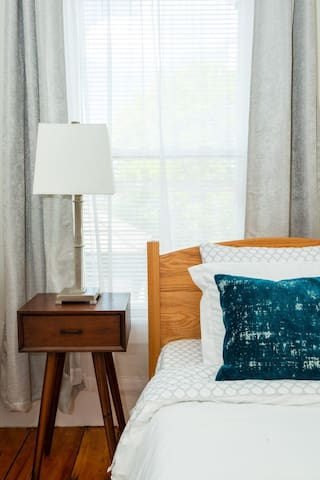 Cozy guest bedroom with plush sheets and memory foam mattresses