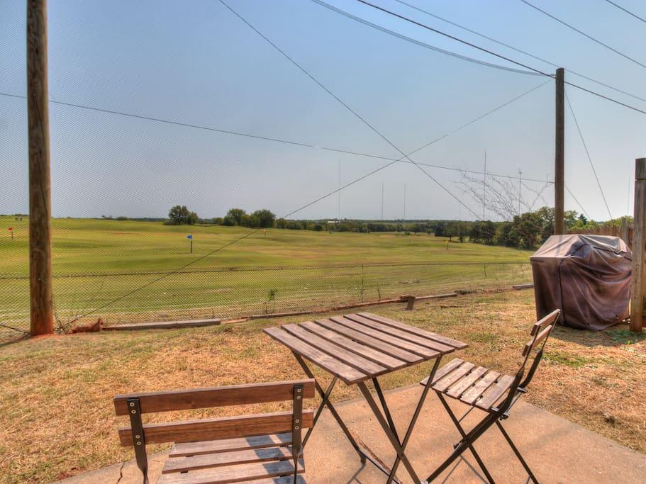 Backyard of duplex looks on silver horn public golf course driving range