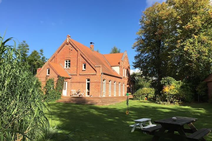 Brightly furnished apartment in an old farmhouse