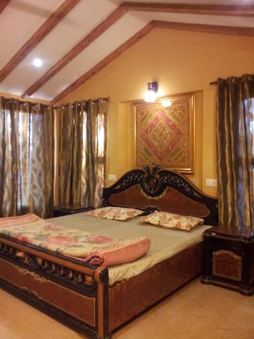 One bedroom at riverside homestay in Dharamsala