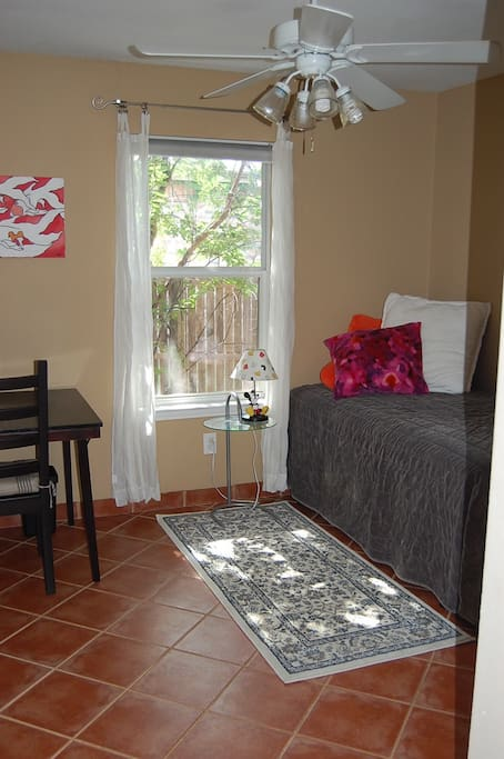 Room has a table/desk, closet, chest of drawers, fan and a single bed.  Wifi included.