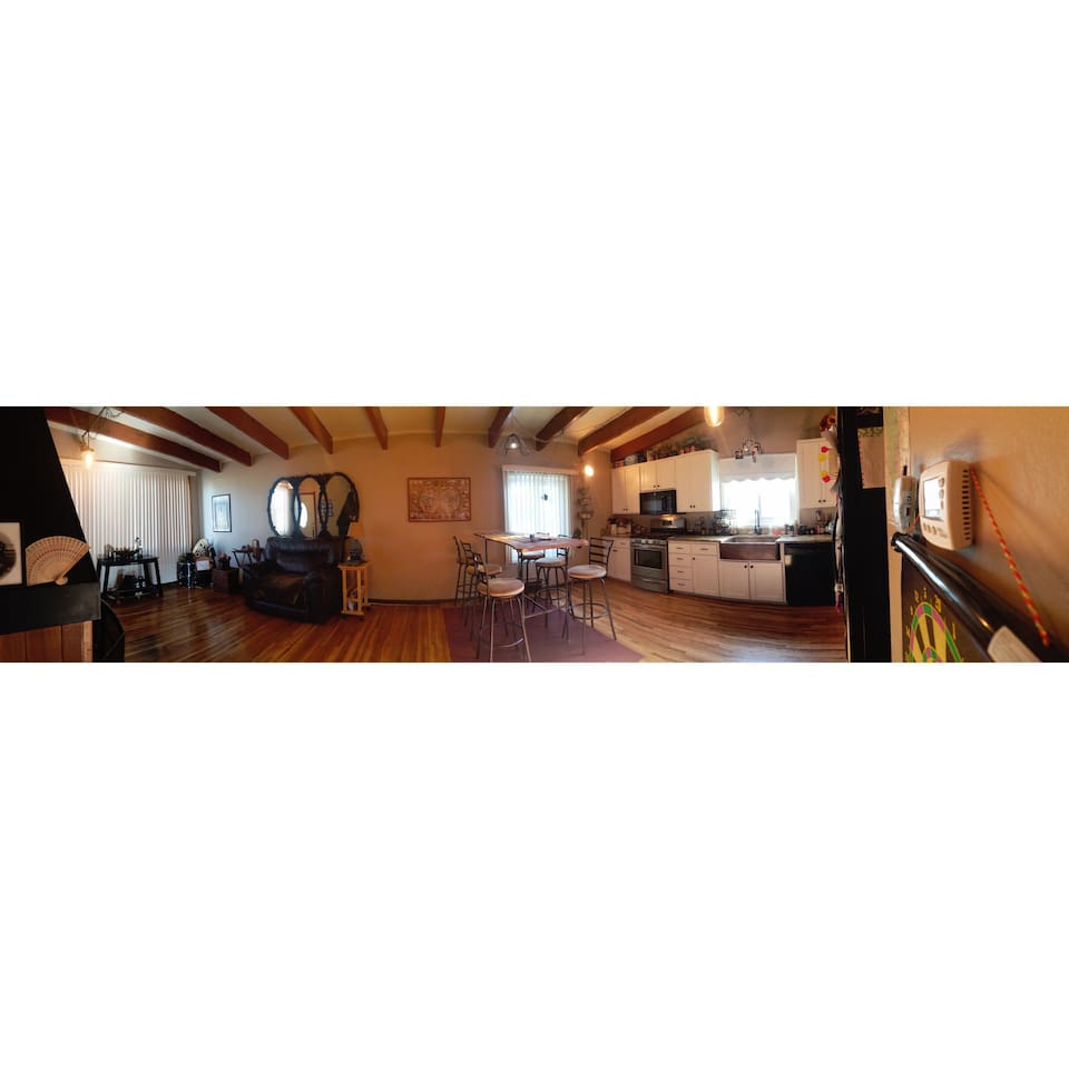 Panorama of living room & kitchen