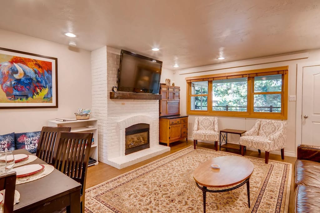 """Comfortable living space with plenty of seating, gas fireplace, new 60"""" TV, new chairs and new rug (added late summer 2018)"""