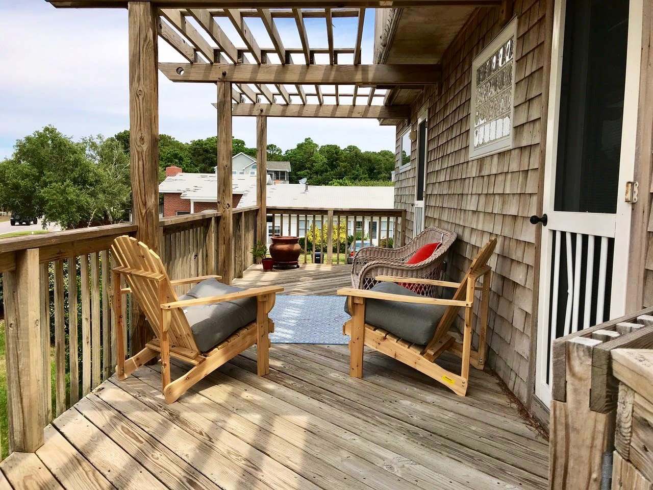 Second level deck entrance to your suite which overlooks the Currituck Sound . The entry door is fitted with pad dial lock so easy & private check in .