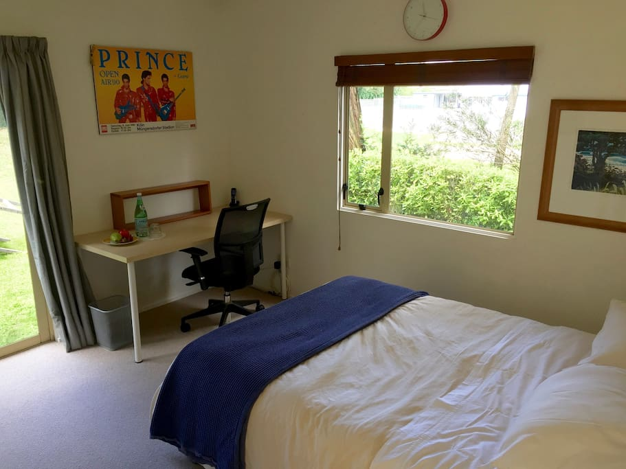 Work desk in the guest room; the window looks out onto the primary school playing field