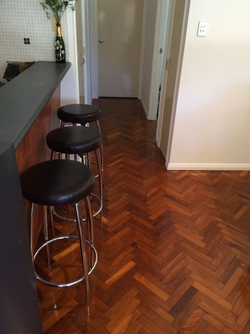 Parquetry Flooring Throughout Living Areas