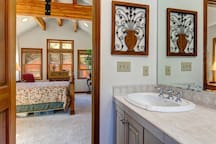 The master bathroom also offers a walk-in shower and double vanities .