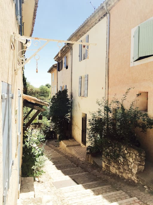 This is our street, the studio is on the ground floor of the house with blue shutters