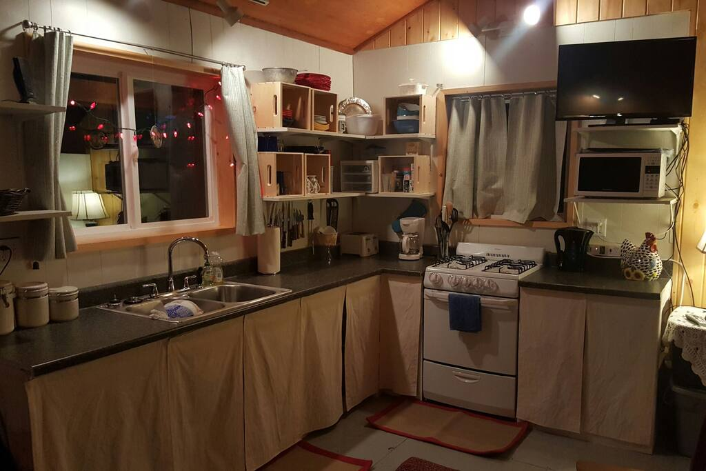 Kitchen has large side by side fridge/freezer with in door water and ice. All utensils, dishes, pots, pans, and cookware you need to make a great meal are available.