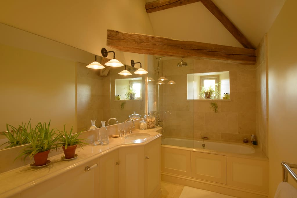 French Room's en suite bathroom with shower over bath.
