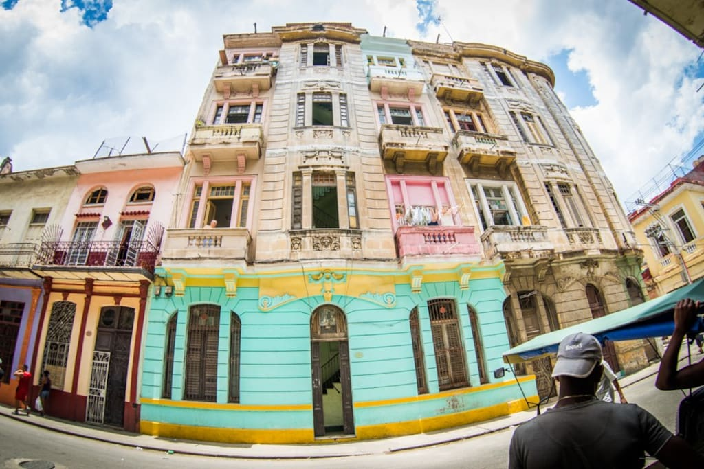 Our building (turquise and yellow) our balcony is the the second one up on the right (above the pink one with the laundry)