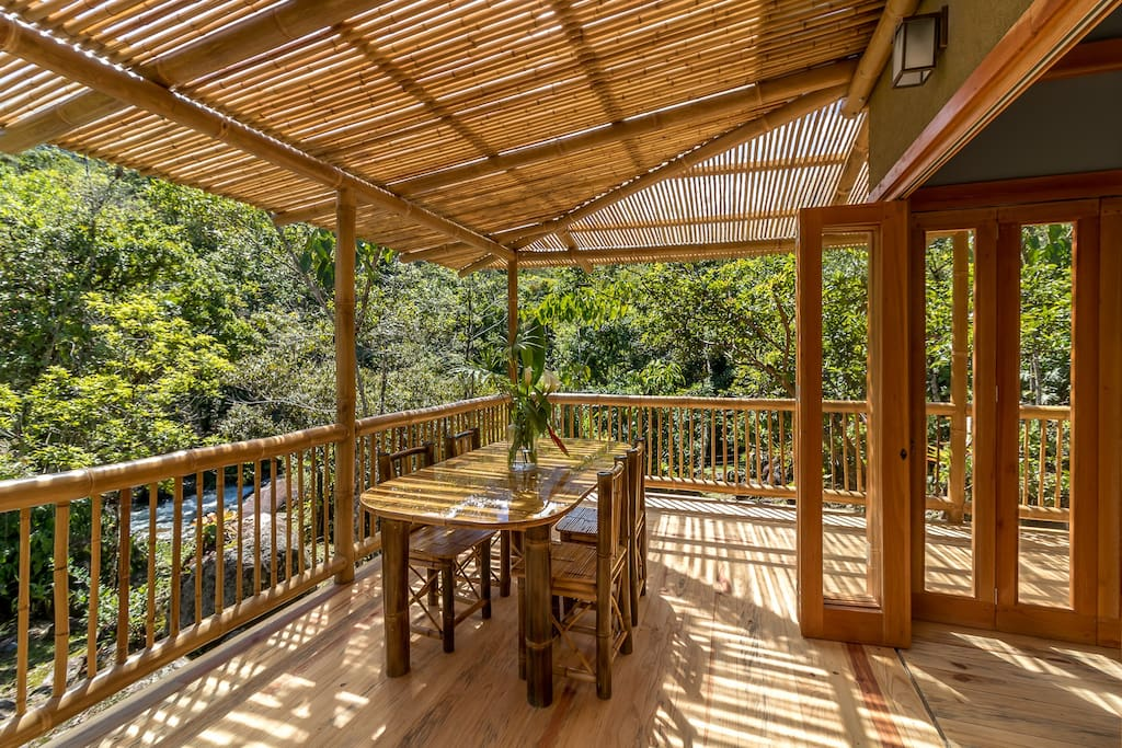 Covered deck and eating area with river view