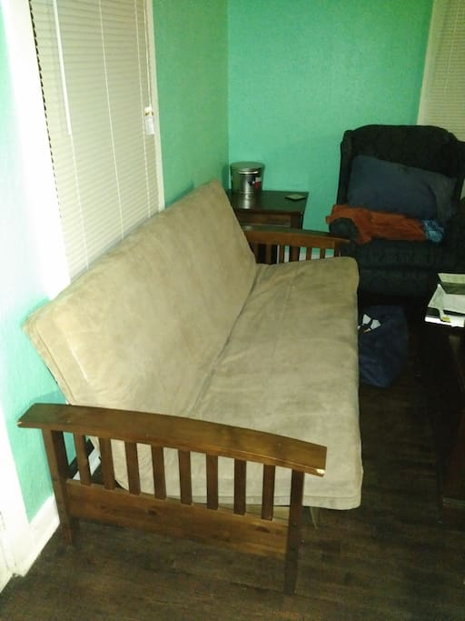 The futon for sleeping in it's upright position...