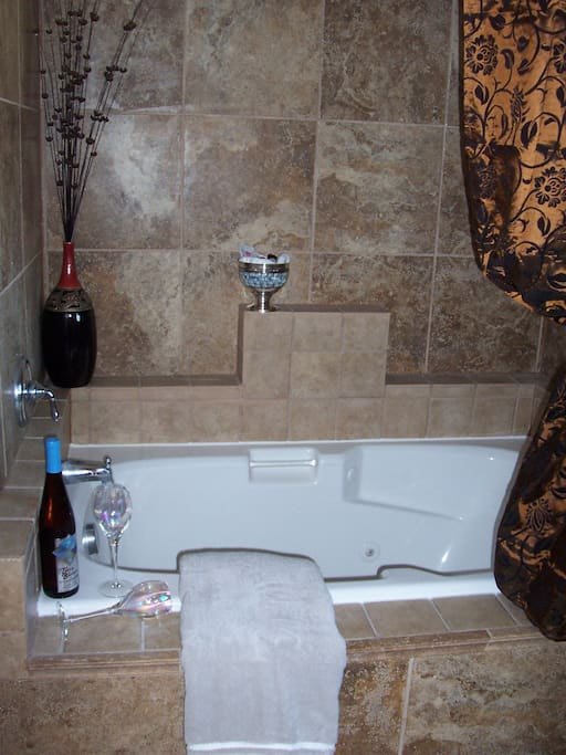 The gas fireplace can be seen from your Private Jetted-Tub.