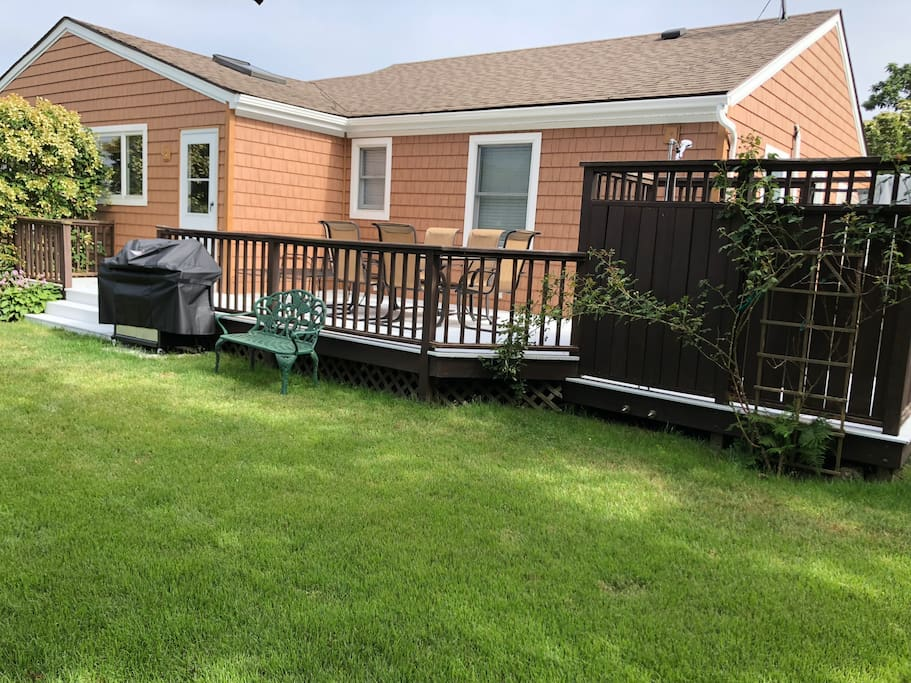 Rear of home - patio set, outdoor shower and grill