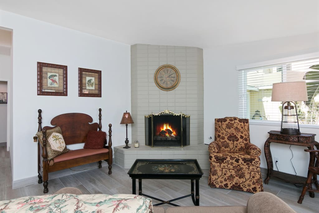 Seating surrounds the fireplace in the living room