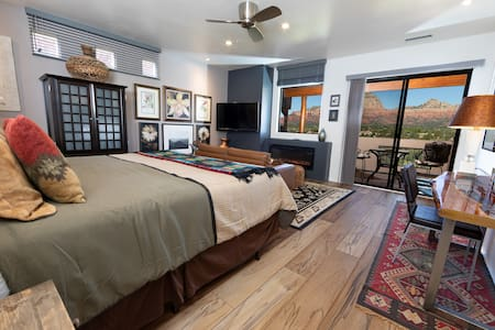 The living/bedroom has a king bed, panoramic red rock views throughout, electric fireplace, HDTV, iPod dock, armoire, traditional southwest leather sofa and full kitchen.