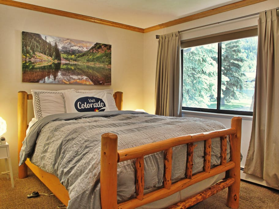 Memory foam bed with heating pad and log frame (queen) in bedroom